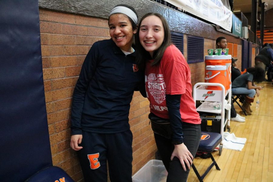 Erin Walker and Luci Lobin enjoy the game.