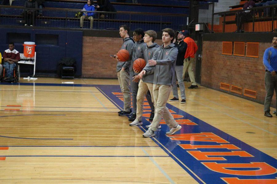 Dylan Casey, Jack Hart, Antonio Garcia and Avi Shapiro help with warm ups.