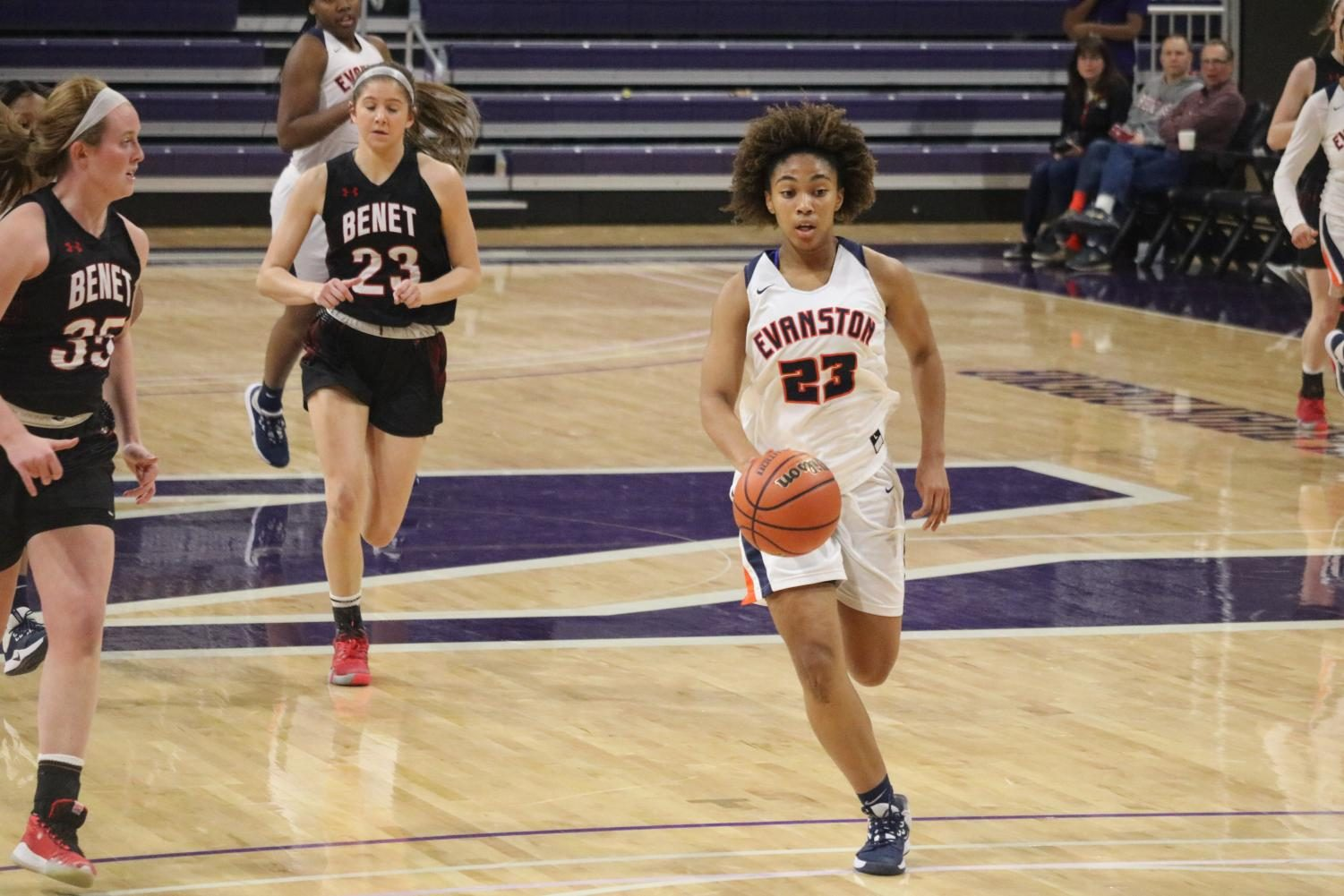 Senior Kayla Henning dribbles ball down the court at last night's game.