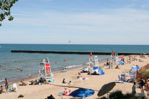 Evanstonians return to Lighthouse Beach after its reopening.