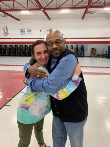 "Lowe and Young at an IHSA Journalism competition in 2018 — and the famous ""big  Rodney hug."""
