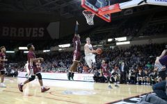 Blake Peters goes up for a layup in the 4A State Championship game against Belleville West
